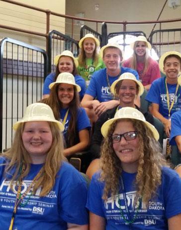 group of ambassadors wearing safari hats